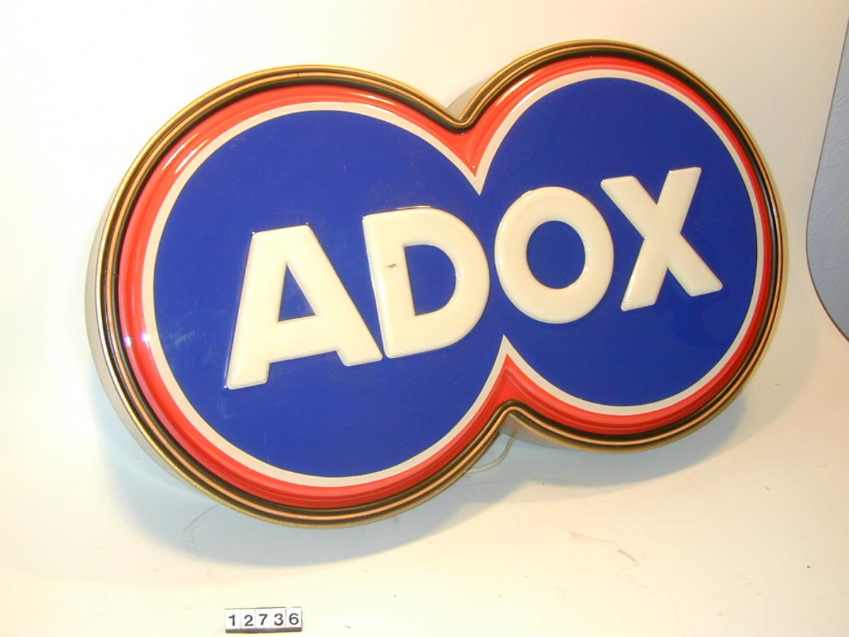 Adox reklameskilt for foto/ film. Elektrisk. Form: Liggende åttetall