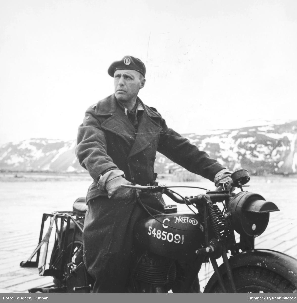 På Banak flyplass. En offiser på en 'Norton' motorsykkel.