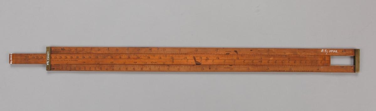 Linjallignende verktøy med en midtdel som kan skyves frem og tilbake.