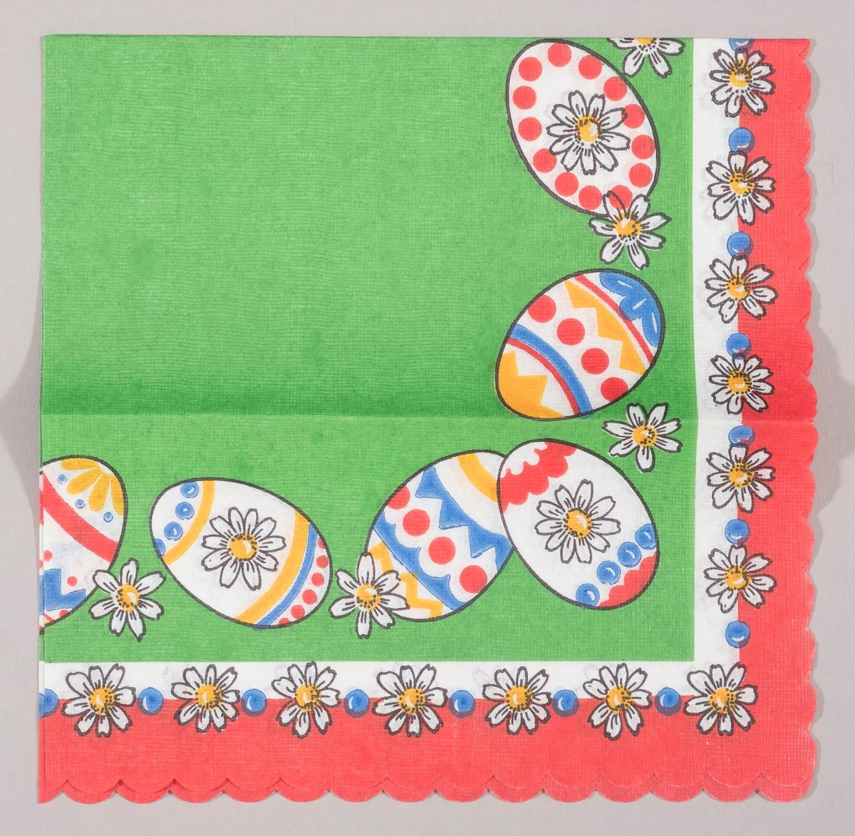 Dekorerte påskeegg og hvite blomster på en grønn bakgrunn. Hvite blomster og blå prikker på rekke på en hvit og rød kant.