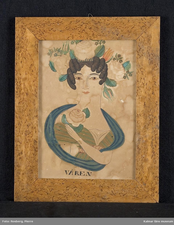 Porträtt av en kvinna med blommor i håret.