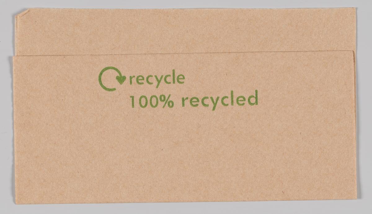 En reklameserviett som forteller at den er 100% resirkulert (ukjent produkt).