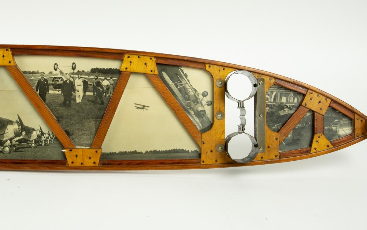 Fotografier inmonterade i en vingsprygel av trä. Fotografierna är tagna på Malmen i Linköping.