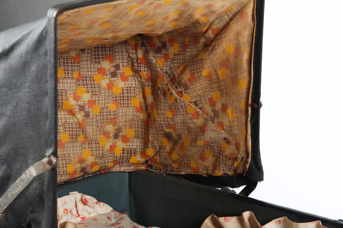 Dukkevogn med sengetøy