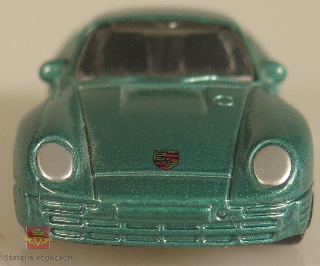 Modellbil av en Porsche 959, modellbilen er farget grønn.