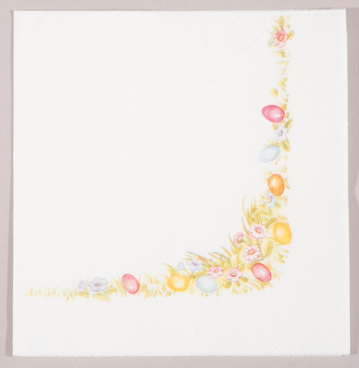 En blomstereng med kulørte påskeegg og små blomster.