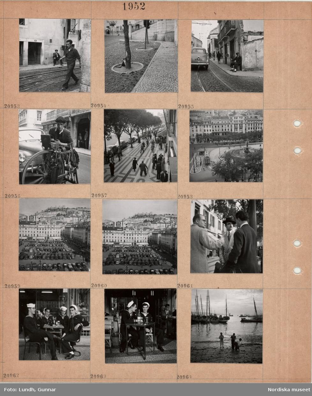 """Motiv: (ingen anteckning) ; """"Lissabon 20895 - 964"""", gatuvy med en man som går vid järnvägsspår, gatuvy med bilar oh fotgängare, en man som troligen slipar knivar på gatan, vy över ett torg med parkerade bilar, tre män samtalar, fyra män i sjömansuniform sitter på en uteservering, barn leker på stranden vid en hamn med båtar."""