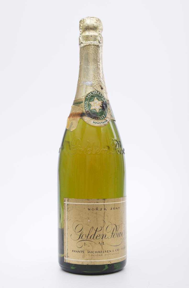 Flaske av grønt glass m/Golden Power i opphevet skrift i glasset. Plombert flaske, gullfarget foliehette - uåpnet, originalt innhold. Plomberingsetikett mrk.FRANTS MICHAELSEN, FILTVET.  Halvtørr. Etikett mrk. NORSK SEKT. Baksideetikett: Golden Power er det suverene norske sektmerke, et ersultat av en mer enn 75-års erfaring og er tildelt de høyeste utmerkelser. Golden Power har en høyere alkoholgehalt enn hjemført champagne og føres over hele landet.  Smaker best godt avkjølt. Produseres kun av Frants Michaelsen & Co, Filtvet. Norges eldste og største sektkjeller.